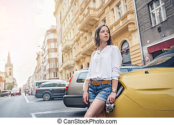 Young attractive woman with a retro camera