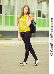 Young attractive woman with bag