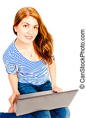 Young attractive woman working at a computer