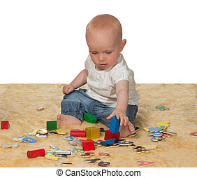 Young baby playing with educational toys - Adorable young...