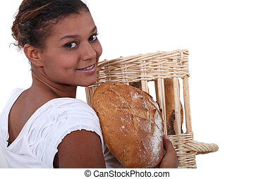 Young baker with a loaf of bread