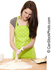 young baking woman cleaning her hands from dough and flour on white background