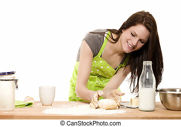 young baking woman forming dough with her hands on white background
