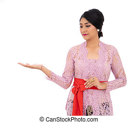 Young Balinese woman with presenting a product