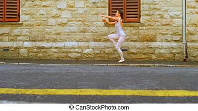 Young ballerina dancer dancing on the street in the city 4k...