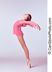 Young ballerina dancer showing her techniques - Young ...
