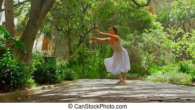 Young ballerina dancing in the park 4k - Young ballerina ...