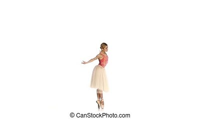 Young ballerina dancing on white background, slow motion