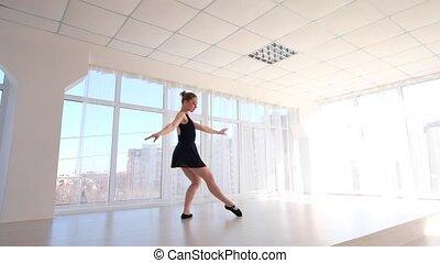 Young ballerina practising ballet moves - Beautiful...