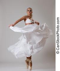 Young ballet dancer in white balletdress