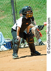 Young Baseball Catcher - A young boy playing the catcher...