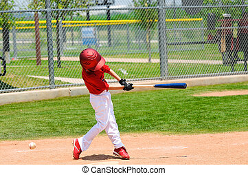 Young baseball player swinging bat