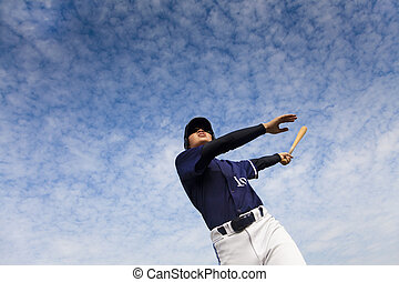 young baseball player taking a swing