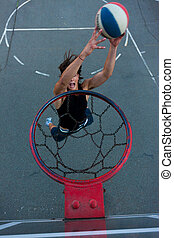 Young basketball player going to the hoop.