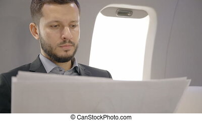 Young bearded chief banker director businessman is analyzing...