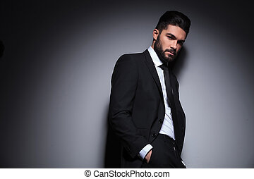 young bearded fashion man looks at you - young fashion man...