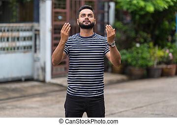 Young bearded Indian man in the streets outdoors