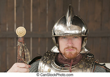 Young bearded Knight in shining armor