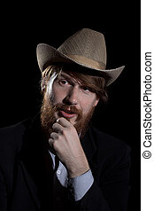 Young bearded man in a hat