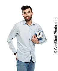 Young bearded smiling man with books in hands on white