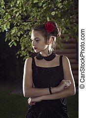 young beatifull girl in black dress