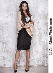 Young beautiful african american girl posing.