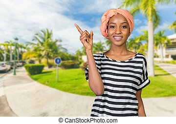 Young beautiful african american woman showing copy space