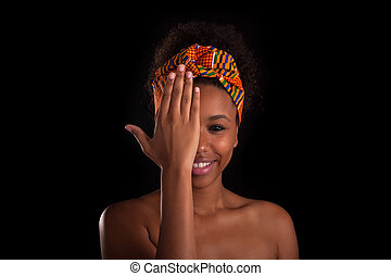 Young beautiful african woman, Isolated over black background