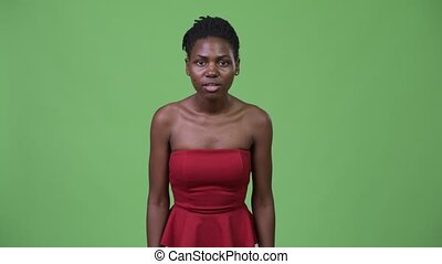 Young beautiful African woman looking excited