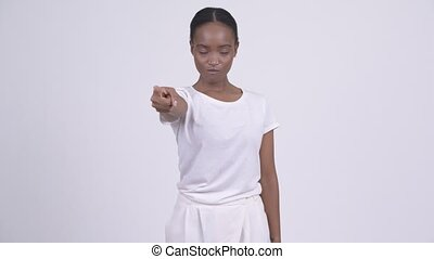 Young beautiful African woman pointing at camera
