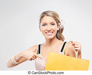Young, beautiful and happy woman with a shopping bag