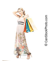 Young, beautiful and happy woman with a shopping bags