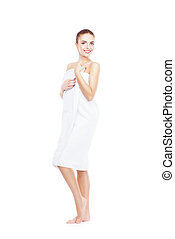 Young, beautiful and natural woman wrapped in towel isolated...
