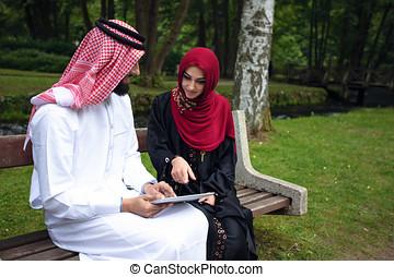 Young beautiful Arabian couple casual and hijab, Abaya,...