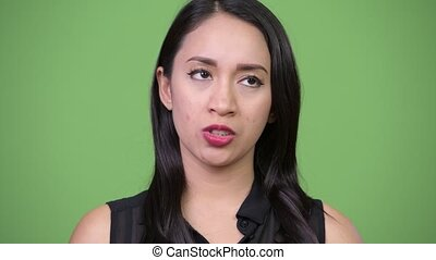 Young beautiful Asian businesswoman looking bored - Studio...