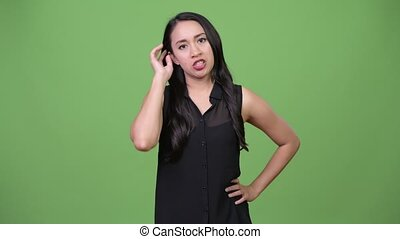 Young beautiful Asian businesswoman looking bored