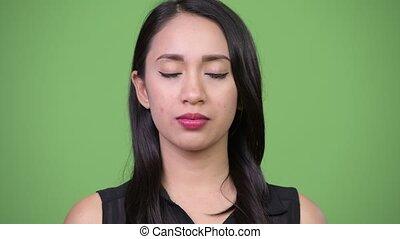 Young beautiful Asian businesswoman relaxing