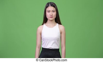 Young beautiful Asian businesswoman