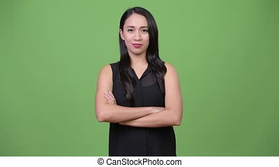 Young beautiful Asian businesswoman with arms crossed -...