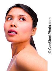 Young beautiful Asian woman posing