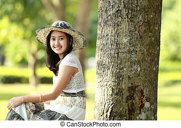 young beautiful asian woman smiling and relaxed