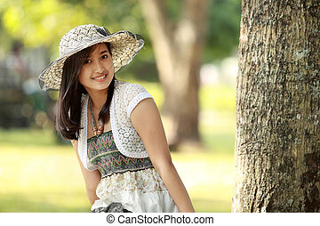 young beautiful asian woman smiling