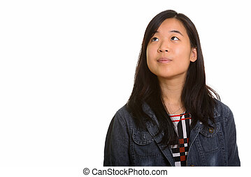Young beautiful Asian woman thinking and planning