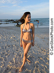 Young beautiful Asian woman thinking while standing at the publi