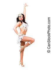 Young beautiful belly dancer in a white costume