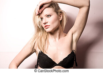Young beautiful blond Caucasian girl on white background.