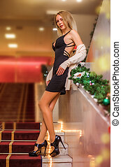 Young beautiful blond girl with long slim legs