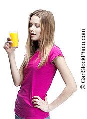 young beautiful blond woman drinking orange juice