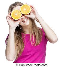 young beautiful blond woman holding orange