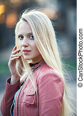 Young beautiful blond woman portrait with wind in her hair
